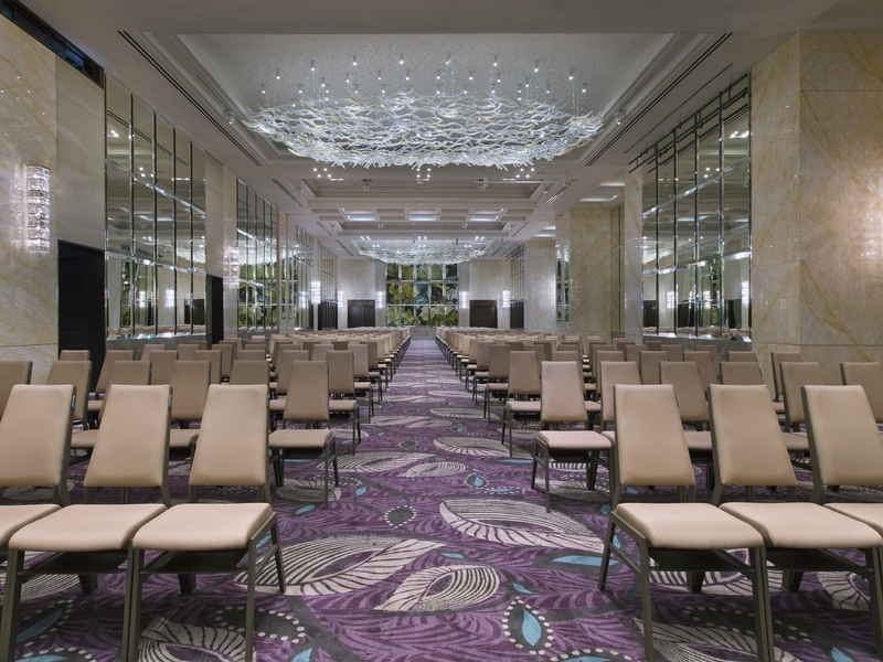 high ceiling ballroom with theatre seating and big pendant light