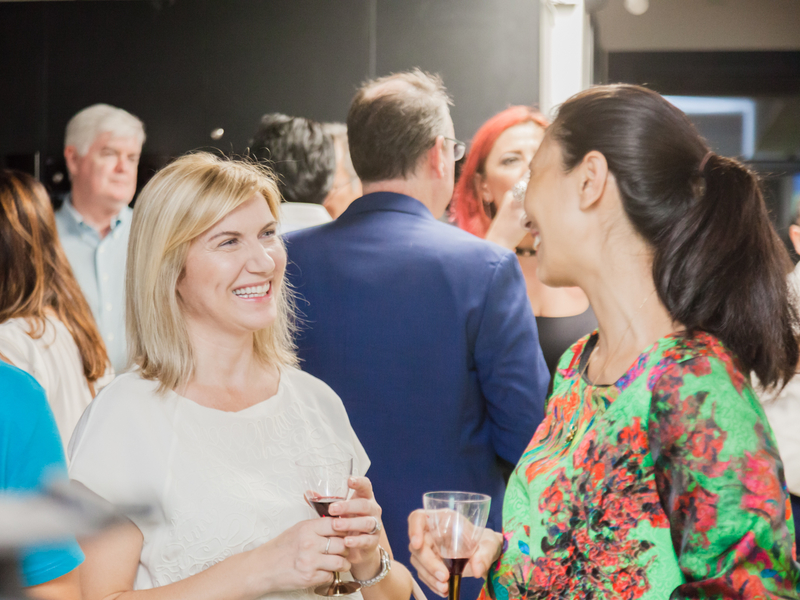 people are networking together during company event