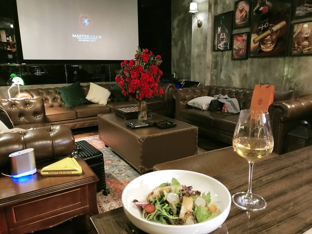 salad and white wine in lounge