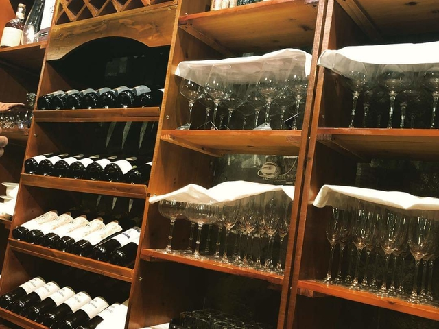 rack full with selection wine and alcohol drinks