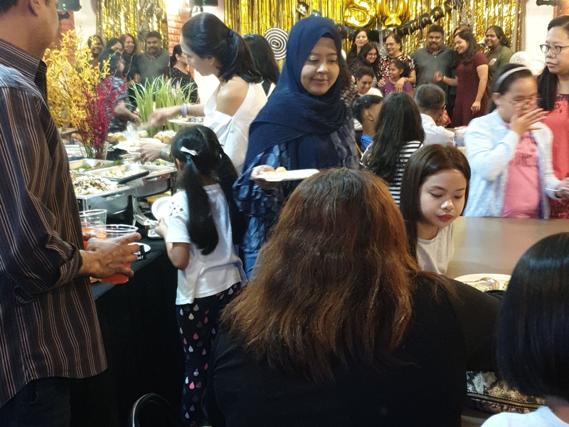 people enjoying food at birthday party event
