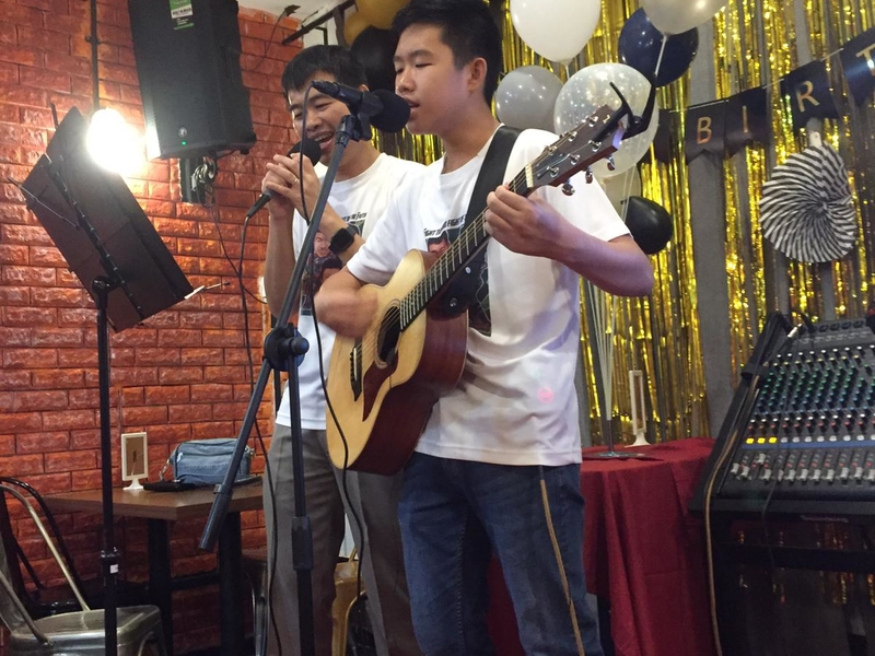 live performance of 2 boys using guitar