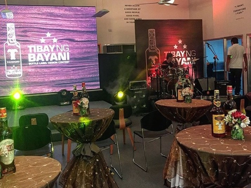 makati product launch space with cocktail tables and large screen