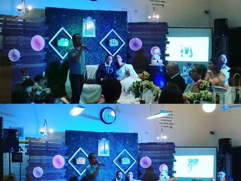 people attending intimate wedding party in makati event venue with projector screen