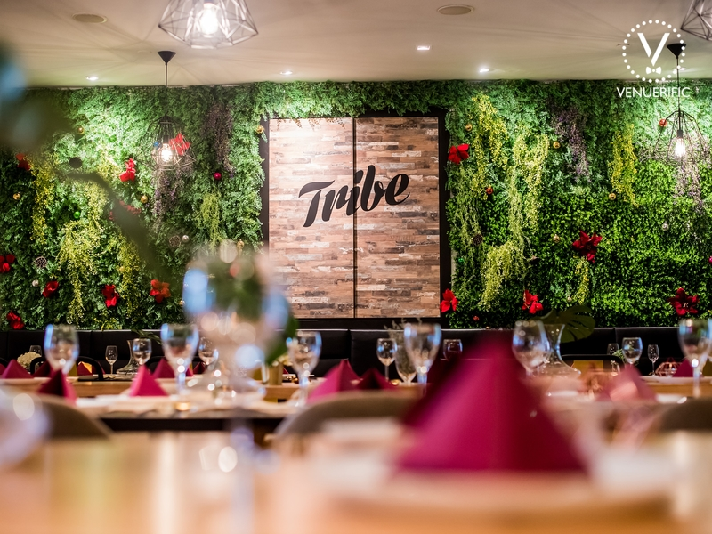 birthday event venue with garden-themed decorations on the wall