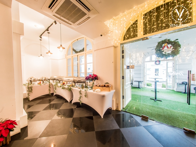 buffet restaurant with white christmas decorations and glass door