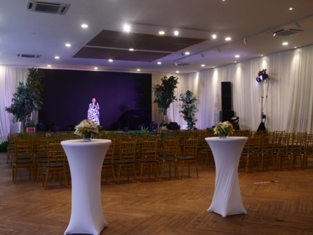 simple decoration with chairs and standing table for music event