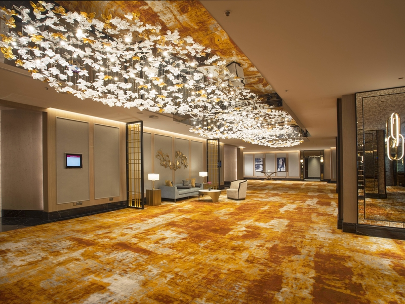 orchard hotel hall with birds lamp decoration and marble floor