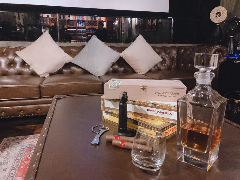 master club lounge area with whisky bottle on table