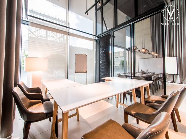 small meeting room with white board and big window with natural lighting