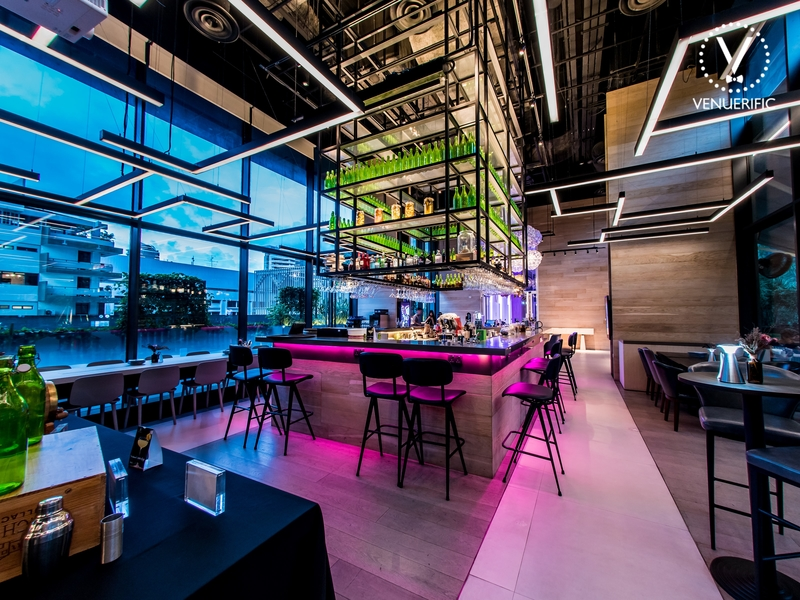 middle bar seating area with purple lighting and natural view