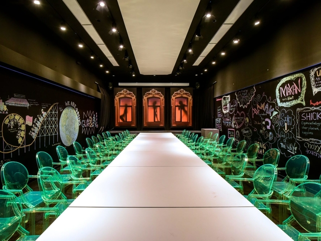 white runway for fashion show with green chair