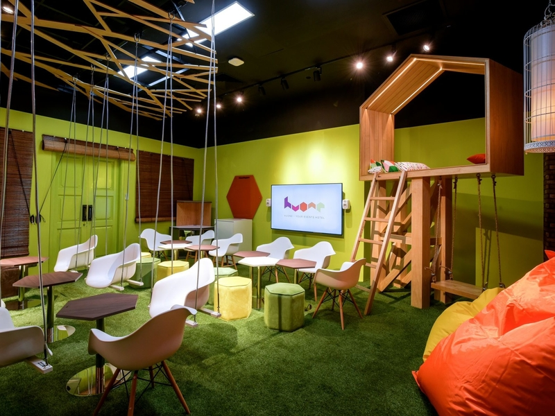 small fun meeting room with green colour and swing inside