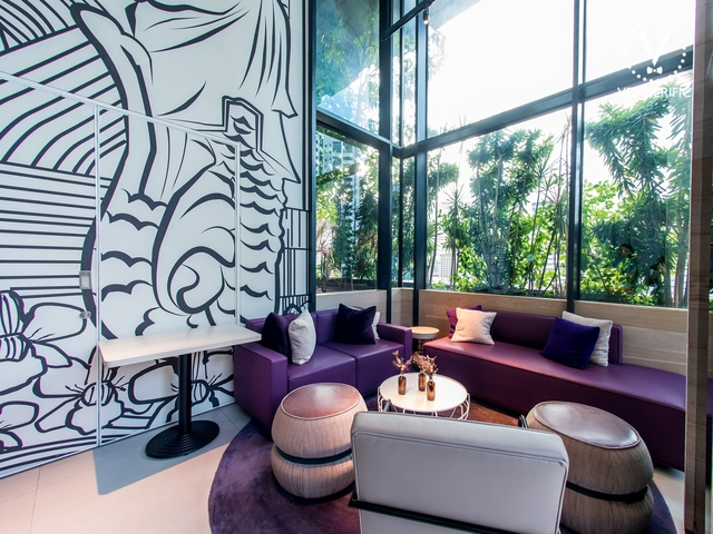 merlion park mural graffiti and cosy purple couch with natural light