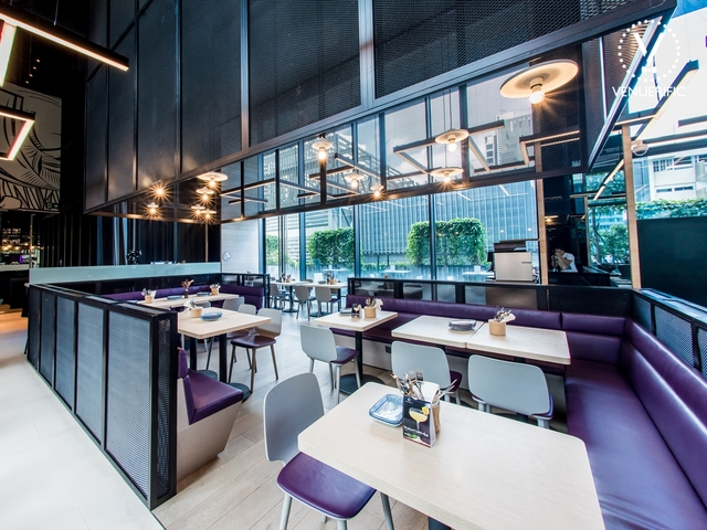 restaurant set up with purple couch and natural light
