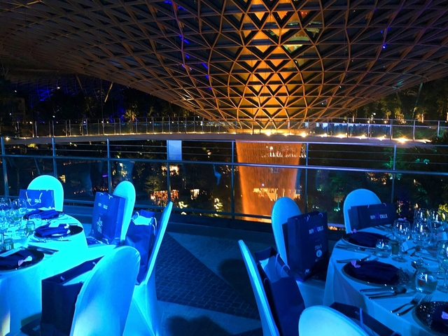 jewel changi for dinner party with blue lighting on table set up beside jewel icon