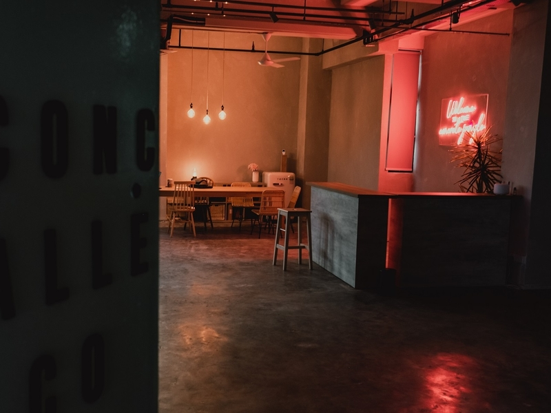 romantic lighting by concrete alley