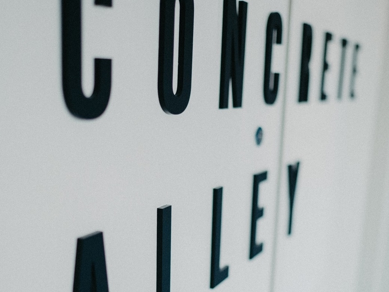 concrete alley wording in black and white