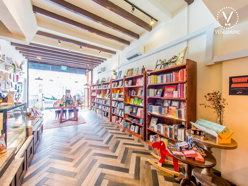 cafe with mini bookstore and arrow patterned floors