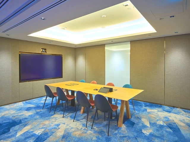 small private meeting room for eight pax with big tv screen