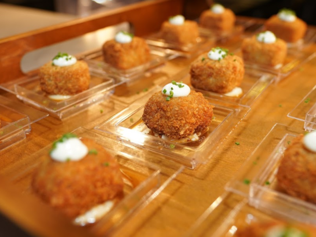 fried appetizer dish with white sauce
