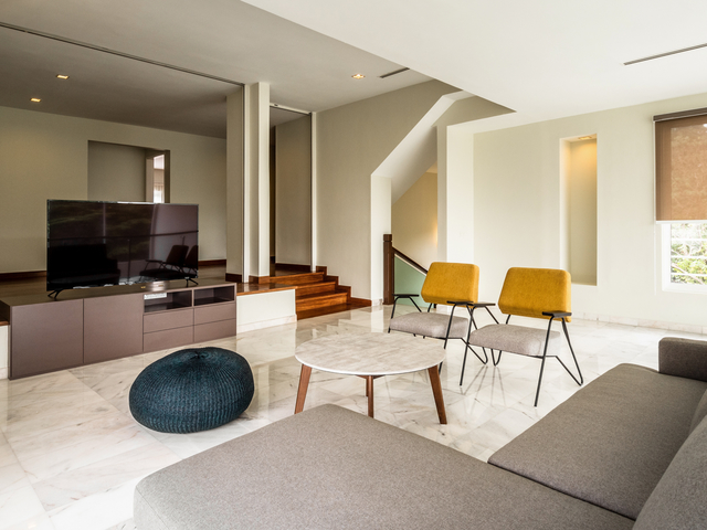 living room with sofa table and tv screen
