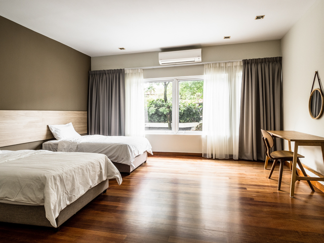 twin bedroom with natural light from the window