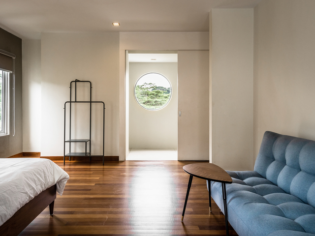bedroom with circle window for natural light