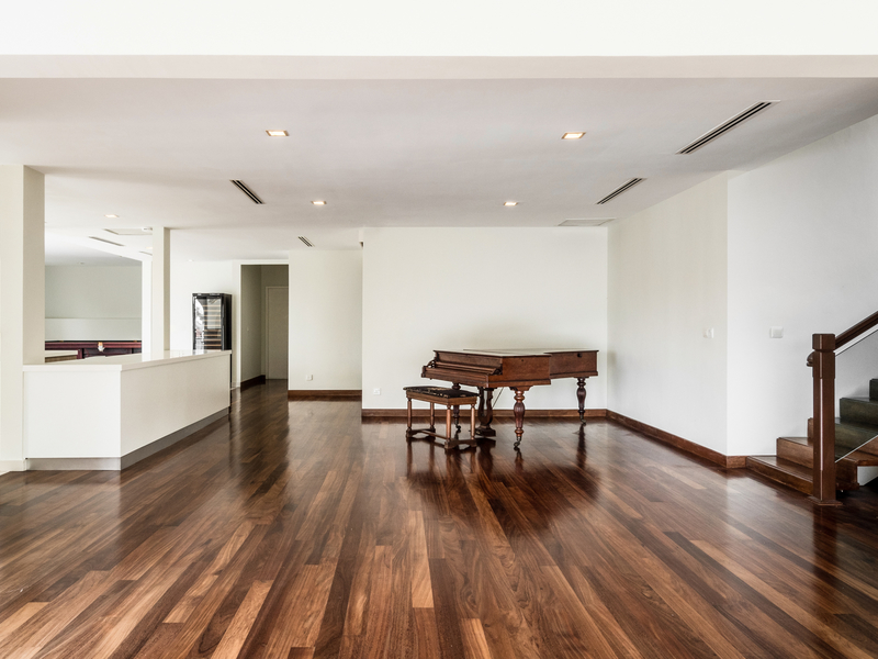 hall area with wooden grand piano at the corner of the room