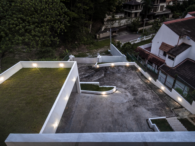 outdoor area of changkat duta luxury villa with hilltop view of skyline kl