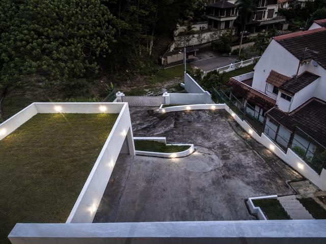 outdoor area of changkat duta luxury villa with hilltop view of skyline kl