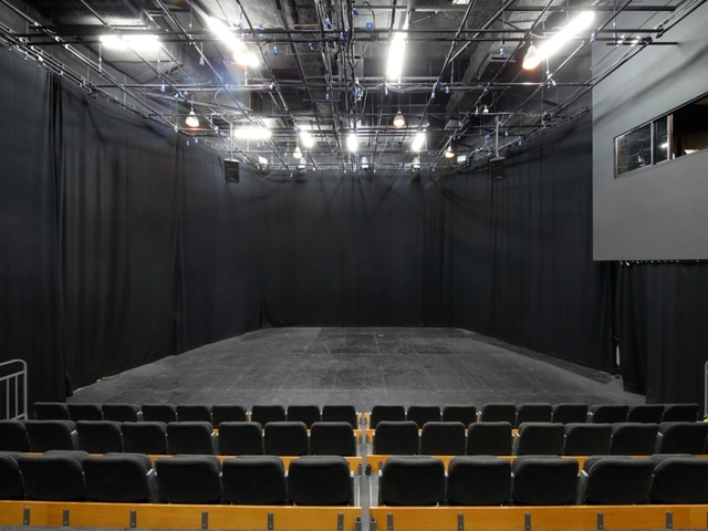 black theme auditorium with stage for performance