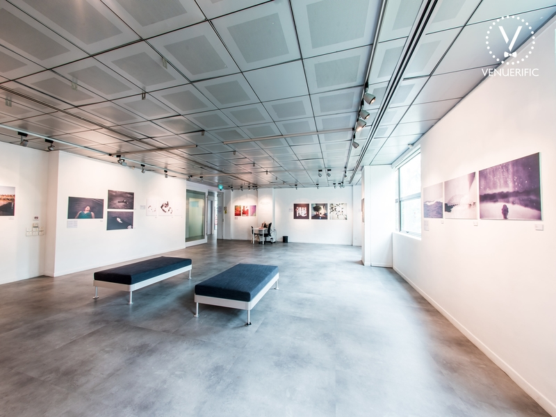 event space for art exhibition with many paintings on the wall