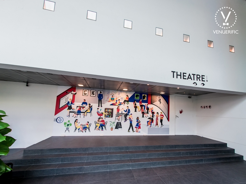 theater building with art on the wall by alliance francaise de singapour