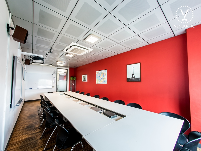 conference style meeting room with one large table and lot of chairs