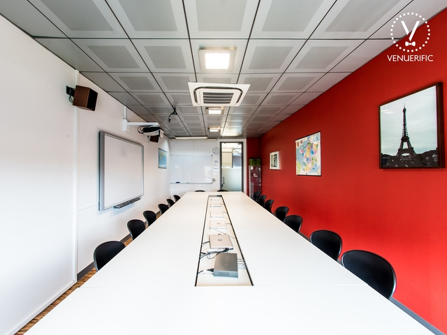 red white meeting room with eiffel tower painting on the wall
