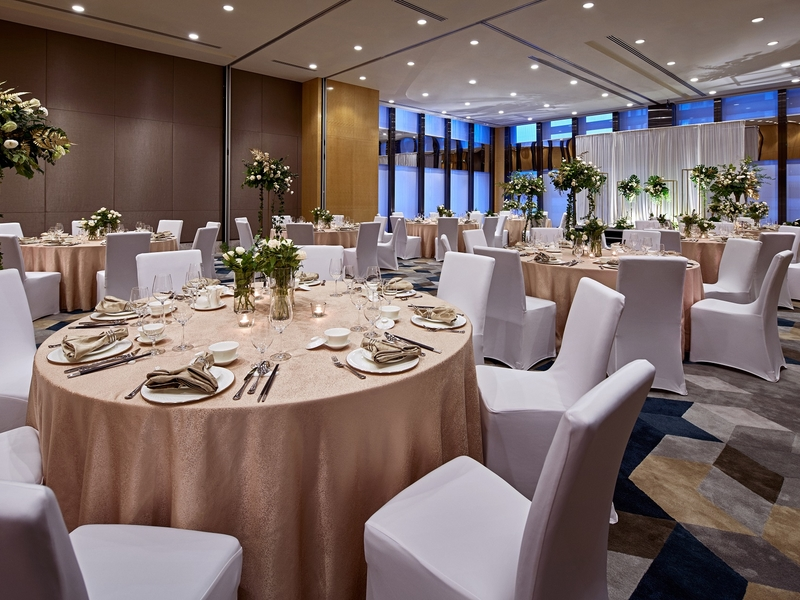 singapore hotel ballroom with high ceiling and several round tables