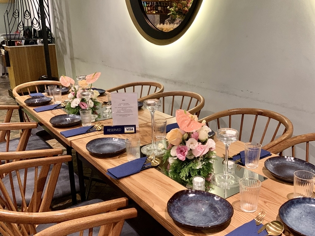 table set up for dining decorated with flower