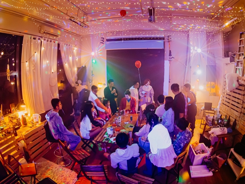 people attending gathering event in singapore small venue with colourful lighting