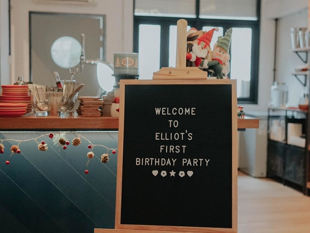 1st birtday party sign board on the table