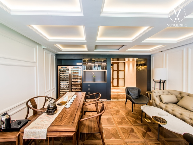 small white meeting room with wooden decoration and connecting hallway