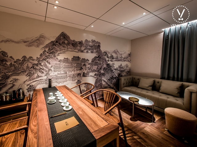 singapore tea lounge with wall art painting and wooden table