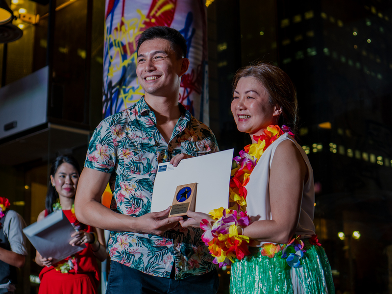 receive award in event with hawai theme