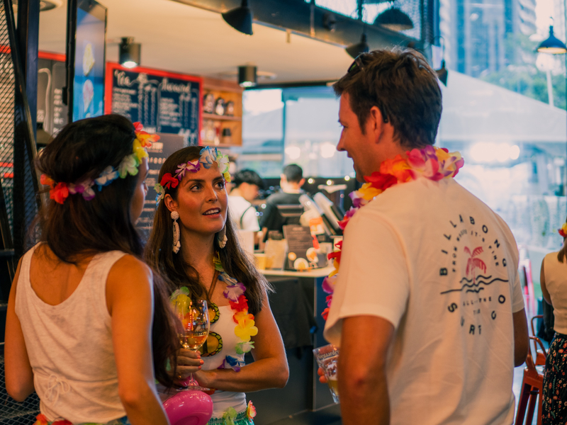 guests with hawai style dress do networking