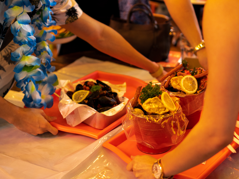 hawai style party with blue flower necklace and seafood