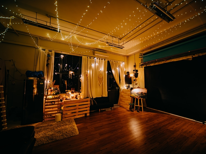 warm ambience event space in singapore with wooden floors for cocktail party event