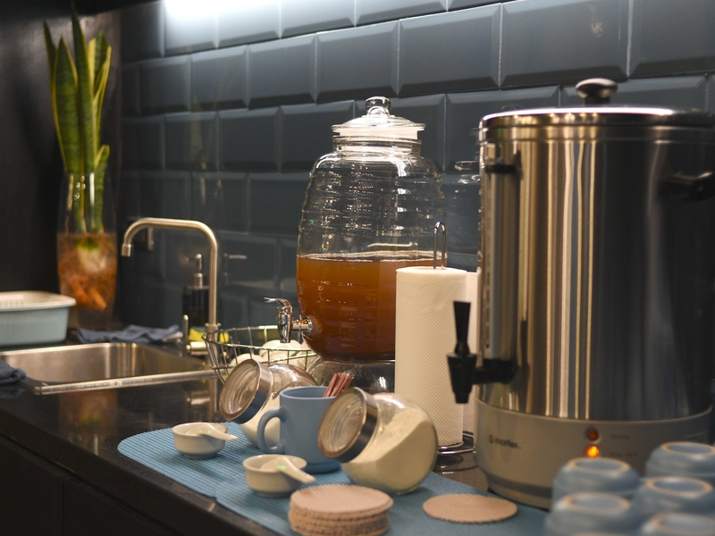kettle of tea next to sink area