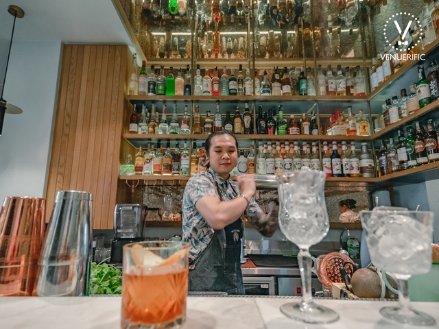 bartender on action to make the best cocktail