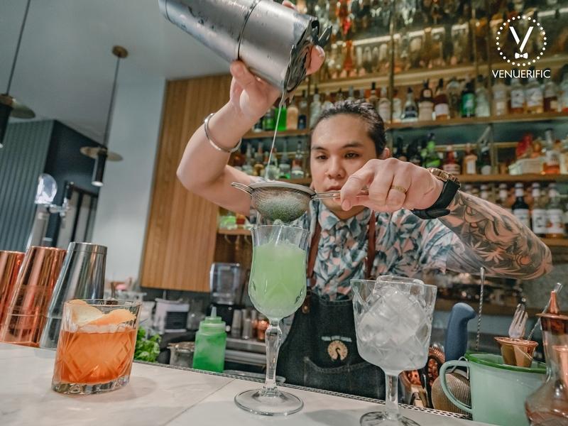 bartender create a unique green cocktail