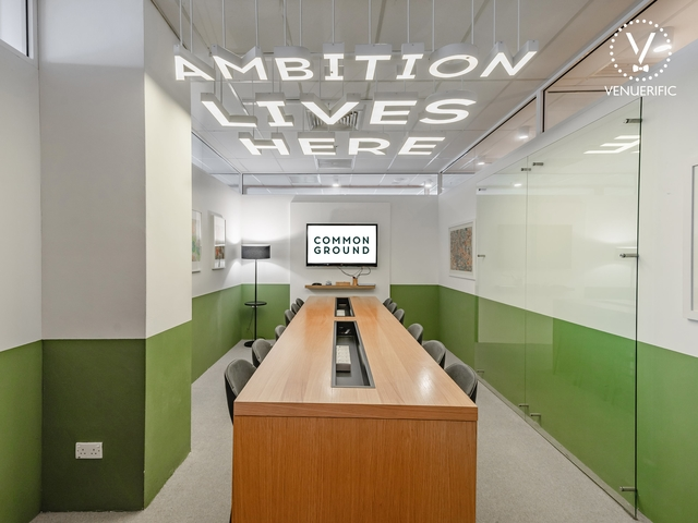 meeting room with quotes hanging on the ceiling said ambition lives here
